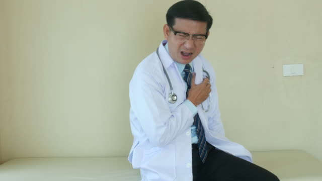 portrait of doctor in face expression , heart attack - mourner stock videos and b-roll footage