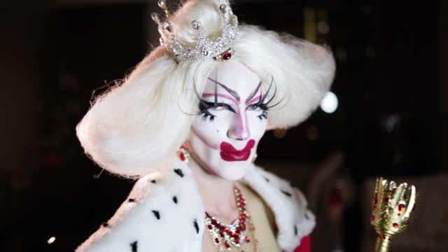 Portrait of drag queen in red dress