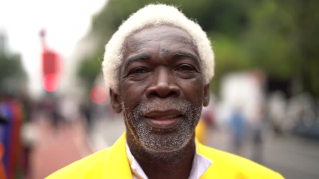 portrait of dreamer senior man at city - the ageing process stock videos and b-roll footage