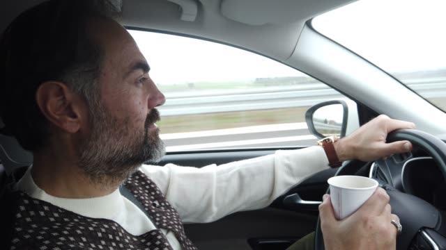 portrait of driver drink a coffee on the highway - coffee drink stock videos & royalty-free footage