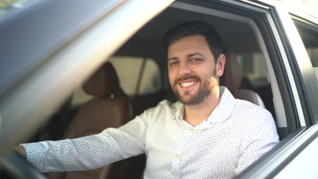 portrait of driver smiling - car interior stock videos & royalty-free footage