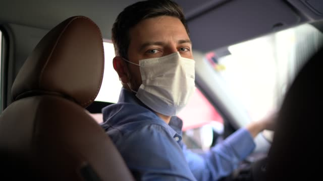 portrait of driver wearing protective medical mask - hygiene stock videos & royalty-free footage
