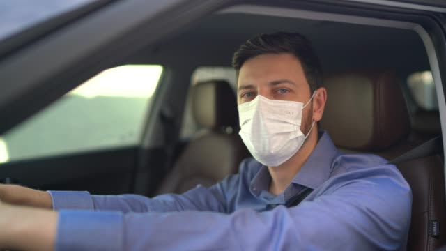 portrait of driver wearing protective medical mask - driver occupation stock videos & royalty-free footage