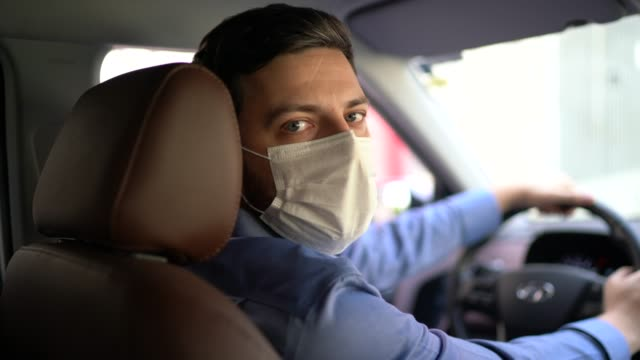 portrait of driver wearing protective medical mask - taxi stock videos & royalty-free footage