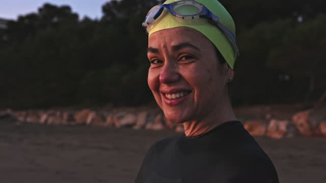 "portrait of early 50s female swimmer on beach at dawn - xavierarnau or ""xavier arnau serrat"" stock videos & royalty-free footage"