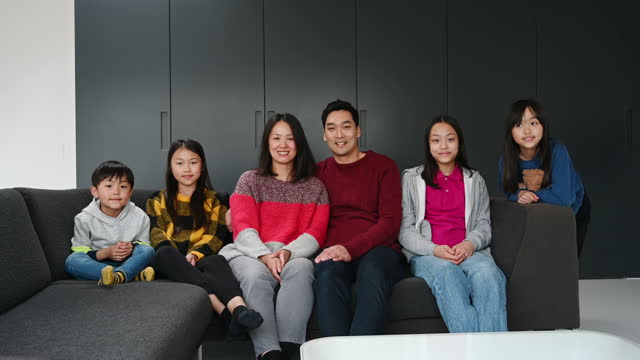 portrait of east asian family relaxing and talking on sofa - 12 13 years stock videos & royalty-free footage