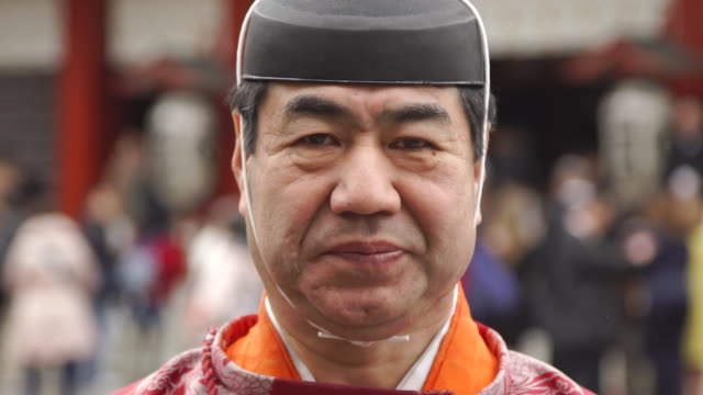 portrait of elderly man in traditional clothing - japan - buddhism bildbanksvideor och videomaterial från bakom kulisserna