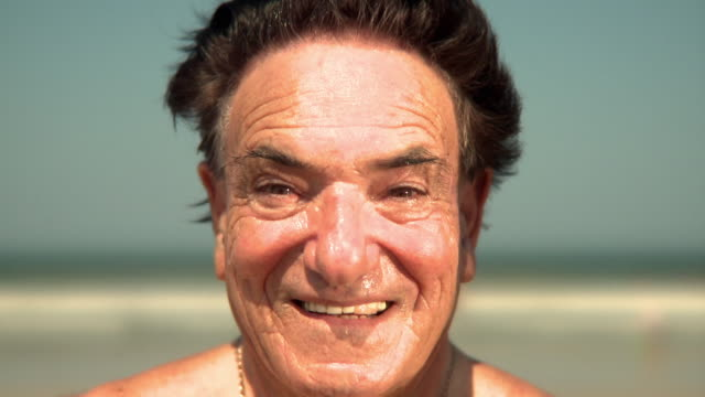 SLO MO CU Portrait of elderly man on beach, Jacksonville, Florida, USA