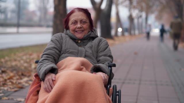 portrait of elderly woman in wheelchair - fragility stock videos & royalty-free footage
