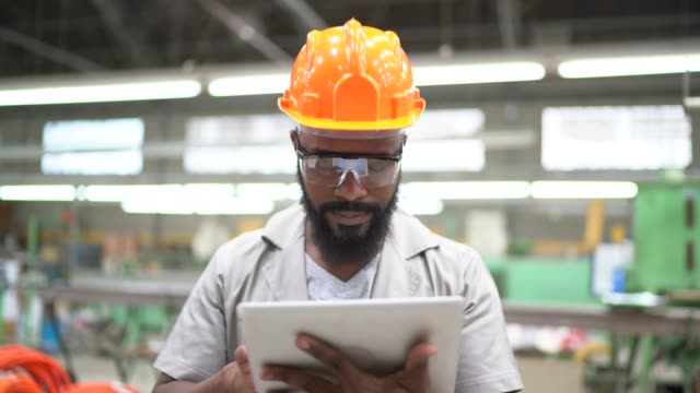 portrait of engineer working with tablet in factory - manual worker stock videos & royalty-free footage