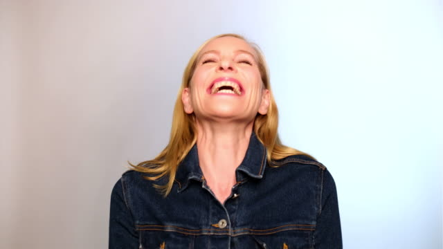 portrait of excited mature woman laughing - 40 44 anni video stock e b–roll