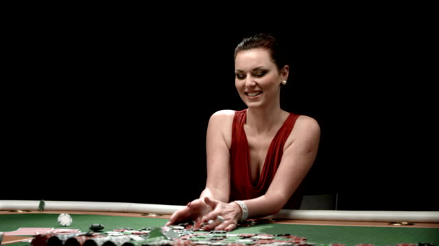 hd dolly: portrait of excited woman winning poker game - casino winner stock videos & royalty-free footage