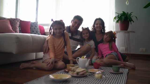 portrait of family doing a picnic indoors at home - picnic stock videos & royalty-free footage