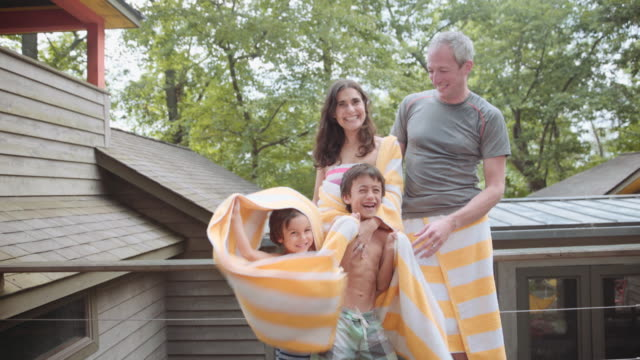portrait of family drying with towels at cabin - wrapped in a towel stock videos and b-roll footage