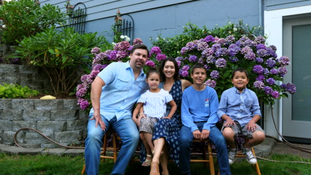 ms portrait of family in backyard garden on summer evening - family with three children stock videos & royalty-free footage