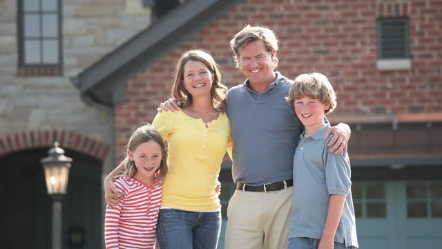 portrait of family in front of house - in front of stock videos & royalty-free footage