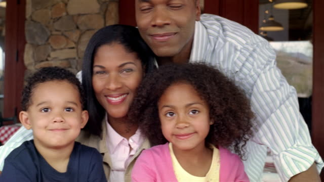 portrait of family smiling at camera - pacific islander family stock videos & royalty-free footage
