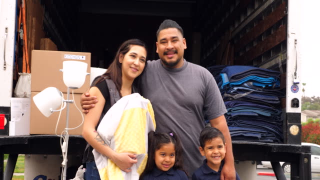 ms portrait of family standing at back of moving truck during move - latin american and hispanic ethnicity stock videos & royalty-free footage