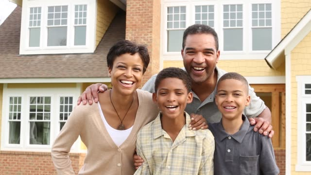 ms portrait of family with 2 children in front of suburban home - middle class stock videos & royalty-free footage