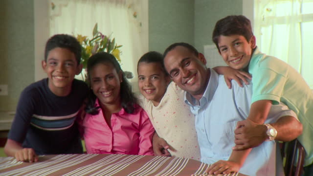 ms portrait of family with three children (7-12) at kitchen table, panama city, panama  - family with three children stock videos & royalty-free footage
