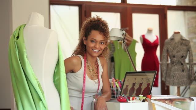 MS Portrait of fashion designer in design studio / Richmond, Virginia, USA