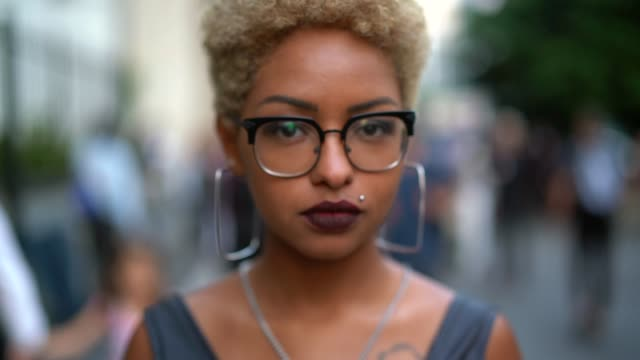 portrait of fashionable woman at city - afro stock videos & royalty-free footage