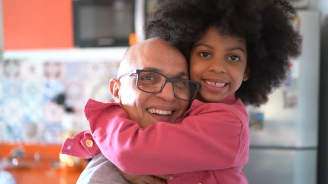 portrait of father and daugher embracing at home - foster care stock videos & royalty-free footage
