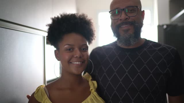 portrait of father and daughter embracing at home - afro hairstyle stock videos & royalty-free footage
