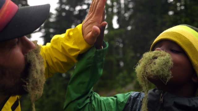 cu portrait of father and son with mustaches made of moss during camping trip - innocence stock videos & royalty-free footage