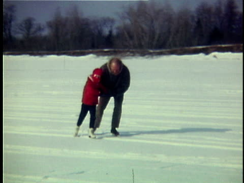 1965 WS CU Portrait of father ice skating with daughter, Ripton, Vermont, USA