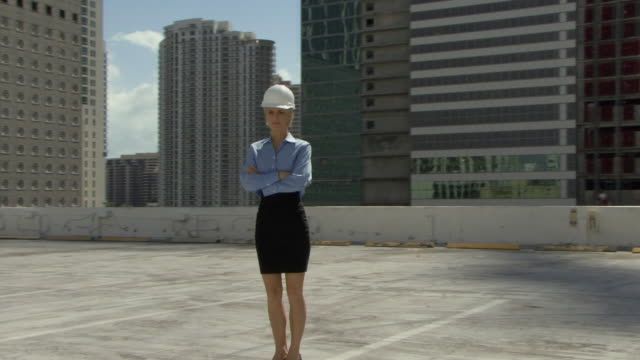 WS DS MS Portrait of female architect wearing reflecting vest and hardhat at construction site / Miami, Florida, USA