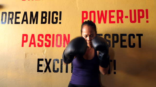 ms portrait of female boxer shadow boxing gym - self defence stock videos & royalty-free footage