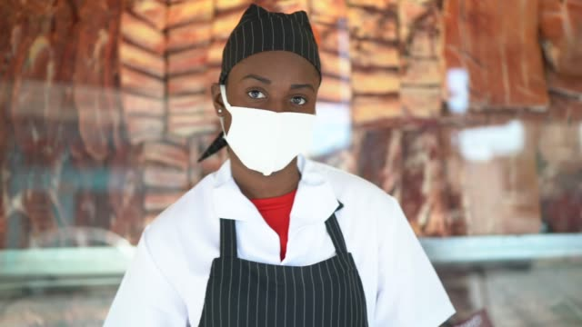 portrait of female butcher working at butcher's shop - with face mask - headshot stock videos & royalty-free footage