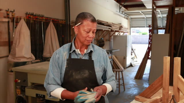 ms portrait of female carpenter in her workshop / santa fe, new mexico, usa - only senior women stock videos & royalty-free footage