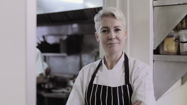 portrait of female chef and restaurant owner - gastwirt stock-videos und b-roll-filmmaterial