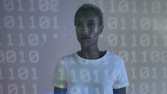 portrait of female coder in front of projection - projektor stock-videos und b-roll-filmmaterial