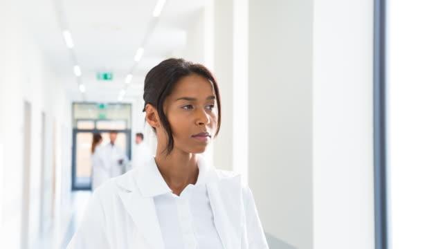 CU portrait of female doctor in hospital
