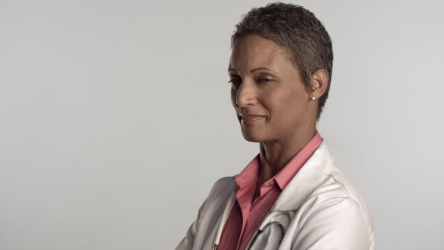 ms portrait of female doctor smiling, studio shot / los angeles, california, usa - white background stock videos & royalty-free footage