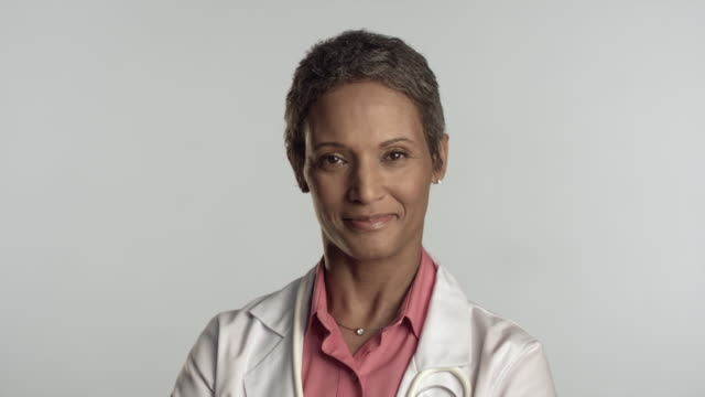 CU Portrait of female doctor smiling, studio shot / Los Angeles, California, USA