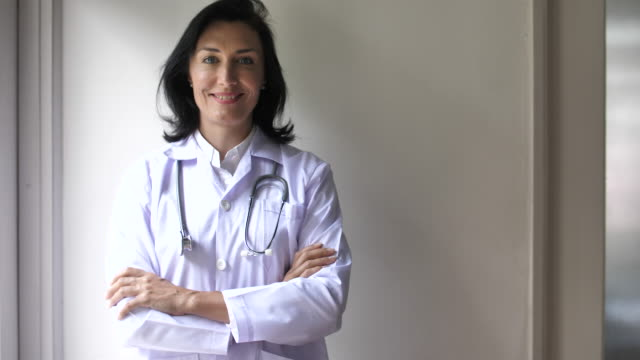 portrait of female doctor smiling - female doctor stock videos & royalty-free footage