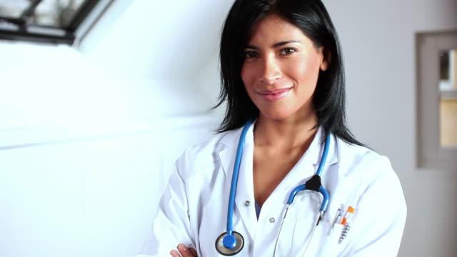 CU ZI Portrait of female doctor standing in corridor, smiling / Brussels, Belgium