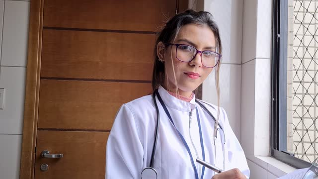 portrait of female doctor taking notes - pardo brazilian stock videos & royalty-free footage