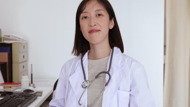 portrait of female doctor - expertise stock videos & royalty-free footage