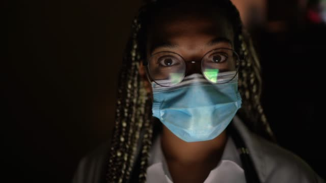portrait of female doctor with face mask - responsibility stock videos & royalty-free footage