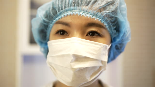 cu portrait of female doctor with mask,china. - female doctor stock videos & royalty-free footage