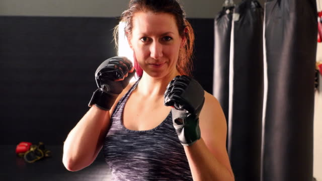 MS Portrait of female fighter in training gym