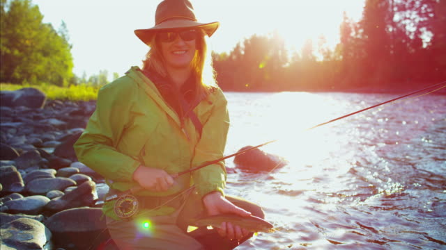 Portrait of female fisherman with Cutthroat Trout Canada
