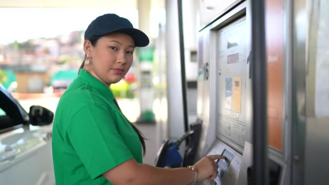 portrait of female gas station attendant at work - petrol station stock videos & royalty-free footage