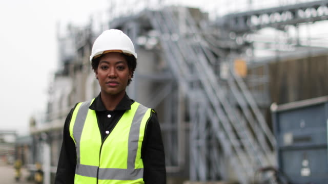 portrait of female industrial worker on site - ingegneria video stock e b–roll