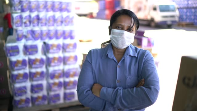 portrait of female logistics employee at delivery company - with face mask - retail manager stock videos & royalty-free footage